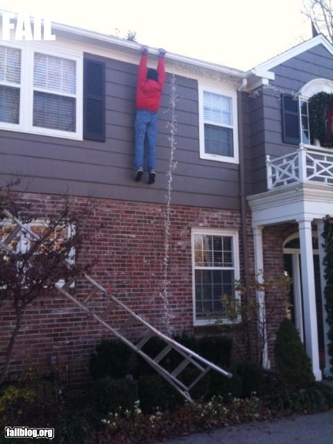 christmas,decorations,display,g rated,hanging,house,lights,man