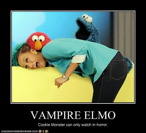 VAMPIRE ELMO Cookie Monster can only watch in horror.