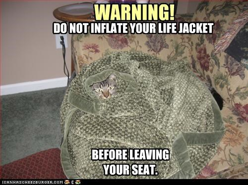 WARNING! DO NOT INFLATE YOUR LIFE JACKET BEFORE LEAVING YOUR SEAT.