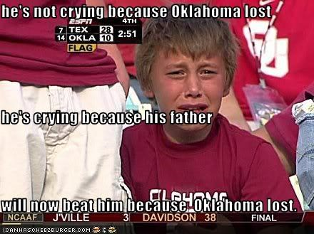 he's not crying because Oklahoma lost he's crying because his father  will now beat him because  Oklahoma lost.