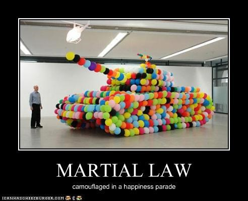 MARTIAL LAW camouflaged in a happiness parade