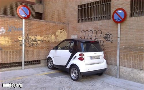 cars failboat in between no parking parking signs smart car win
