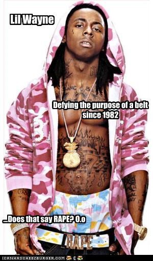 Lil Wayne Defying the purpose of a belt since 1982 ...Does that say RAPE? O.o