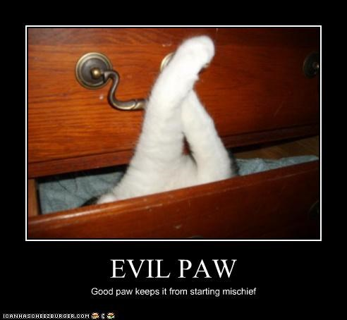 EVIL PAW Good paw keeps it from starting mischief