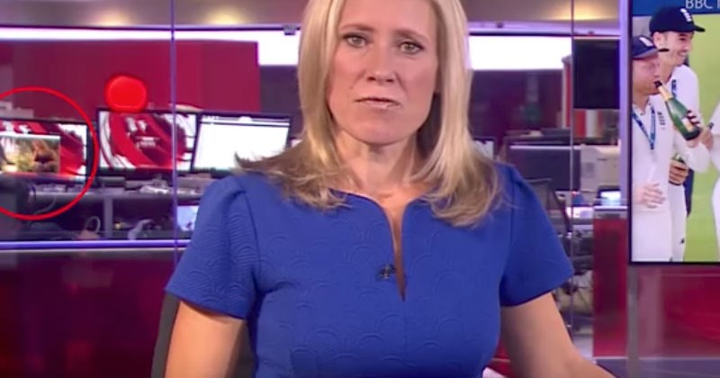 BBC news anchor with embarrassing screen live in the background.