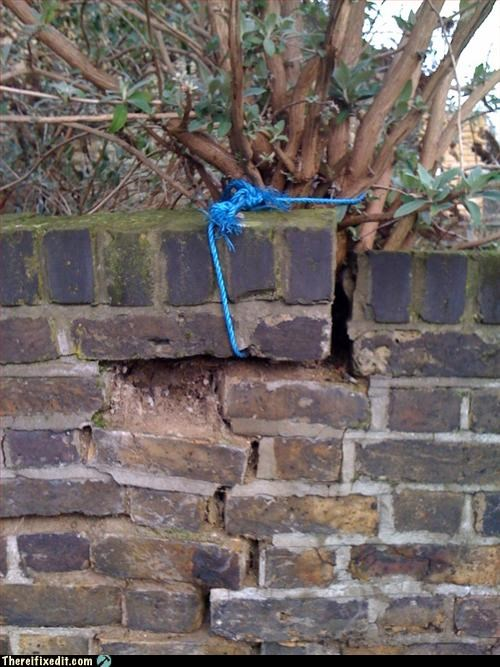 brick,recycling-is-good-right,rope,tied together,wall