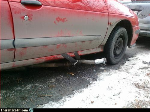 Funny picture of someone who fixed their car's tailpipe by securing it with the passenger side seat belt. Looks fixed to me.