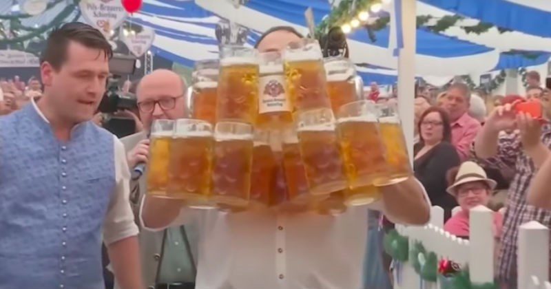 Video of German guy breaking the beer-carrying world record is pretty amazing.