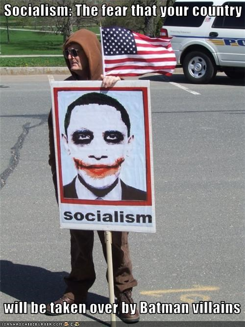 barack obama,batman,protester,signs,socialism,stupidity,teabaggers,the joker