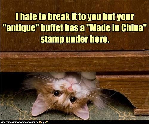 "I hate to break it to you but your ""antique"" buffet has a ""Made in China"" stamp under here."