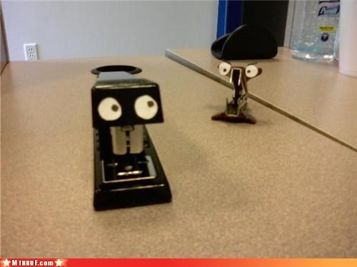 anthropomorphic art boredom creativity in the workplace cubicle boredom desk junk dorky googly eyes hardware office supplies personification scene sculpture staple remover stapler - 3421139456