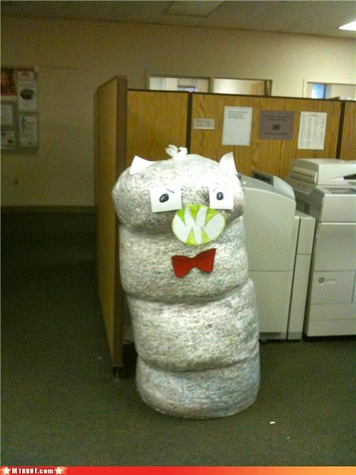anthropomorphic art boredom boring bow tie creativity in the workplace cubicle boredom decoration garbage godzilla monster nerd decor not actually funny sorry personification sculpture shredded paper snowman stack Terrifying uncreative wiseass yellow fangs