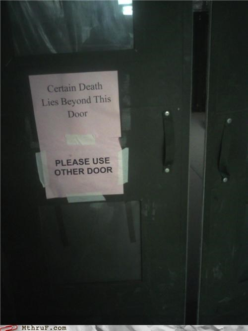 certain death,doom,door,idle threat,not actually funny,paper signs,passive aggressive,sass,screw you,signage,Terrifying,threat,use other door,wiseass