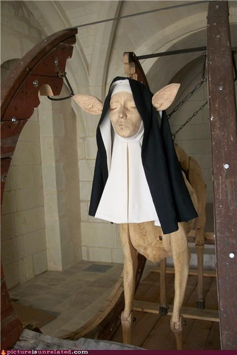 art,blasphemy,deer,monster,nun,sculpture,wood,wtf