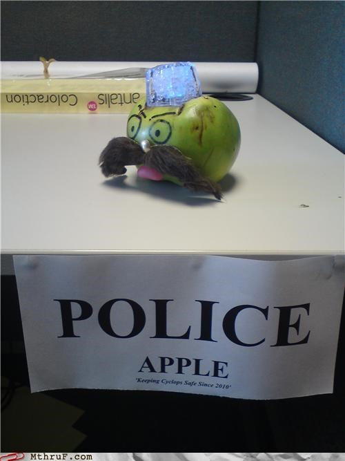 apple,art,awesome co-workers not,boredom,cop,creativity in the workplace,cubicle boredom,decoration,food,led ice cube,moustache,police,police apple,sass,sculpture,seek help,seek therapy,symptom of psychosis,Terrifying,wasteful,weird,wiseass,wtf