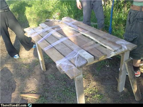 packing tape rickety table wooden planks - 3550863872