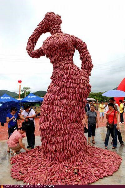 art meaty sausage statue woman wtf - 3621844992
