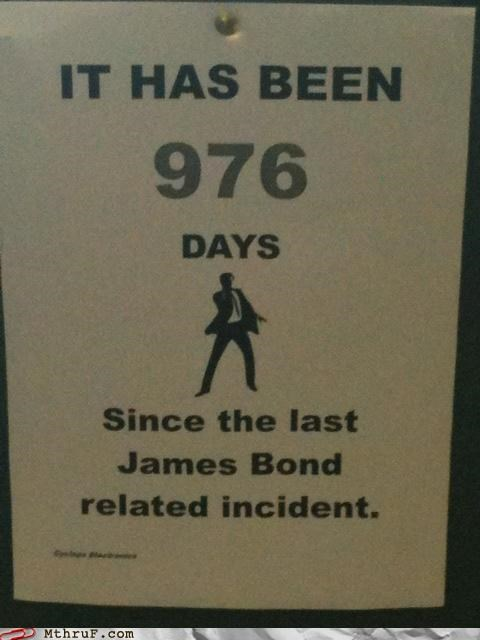 007,accident sign,art,boredom,cartoons,clever,creativity in the workplace,cubicle boredom,decoration,goofing around,humor,james bond,joke,lies,paper signs,prank,signage,silly,wiseass,workplace pride