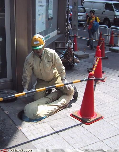 construction fail creativity in the workplace dangerous dumb ergonomics FAIL hard hats hazard idiotic ingenuity manhole moronic safety safety cones sewer uncomfortable work smarter not harder workplace safety