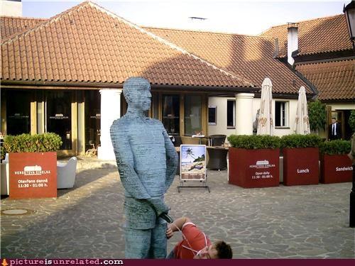 art idiots statue urine wtf - 3687299840