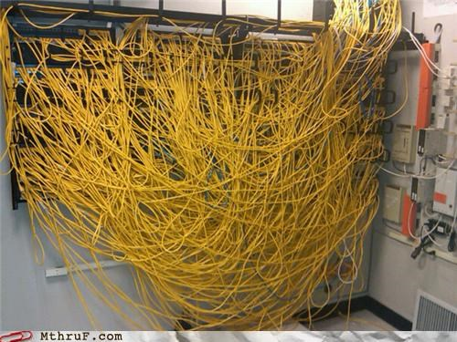 awesome co-workers not busted cables cabling cat5 cat6 disaster disorganized figer gross hardware lazy mess pwned racks sculpture server server room switches Terrifying work smarter not harder - 3688674304