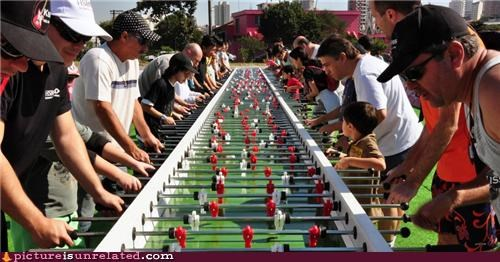 foosball games lots people table soccer wtf - 3707523072