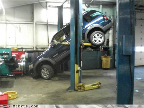 accident auto repair auto shop boned busted car car jack damaged dropped explorer FAIL fired ford greasemonkey fail hardware hydraulic lift leap lift mechanic osha PWND ruined Sad screwed slip slipped suicide suv totalled uh oh whoops