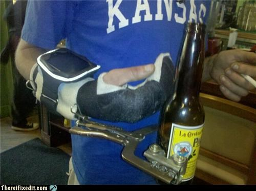 Person with a cast on his arm is using a vice-grip to hold his beer effectively.