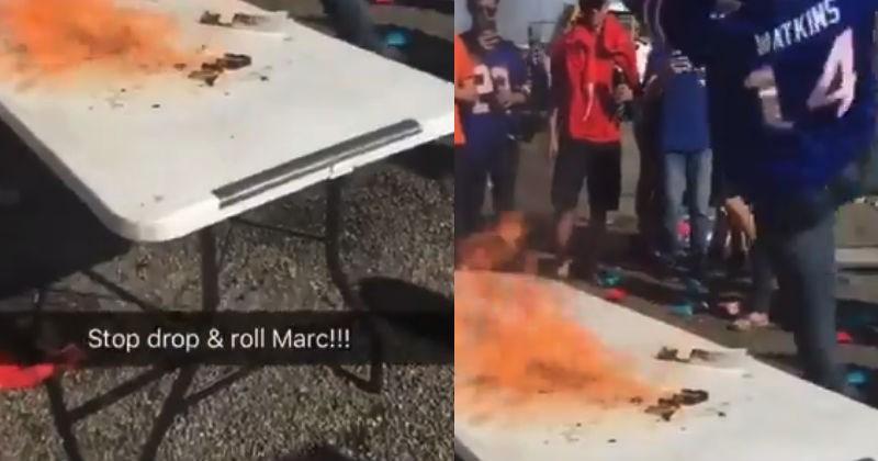 Bills football fan sets himself on fire by jumping on lit table.