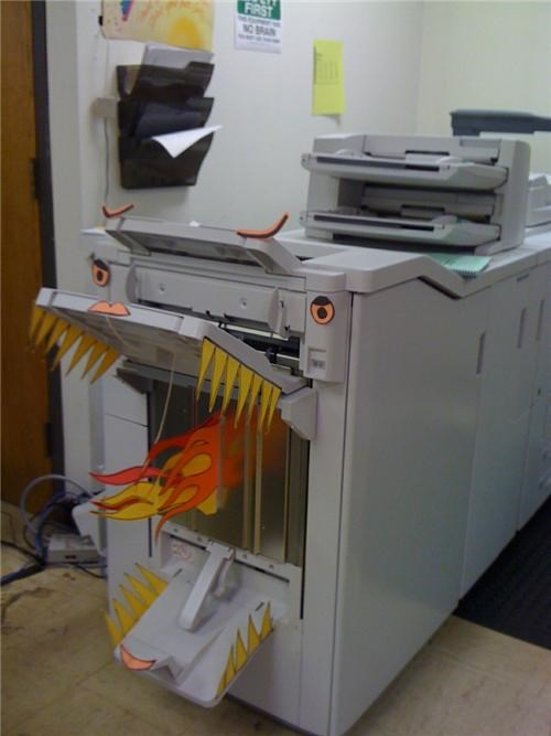 art awesome boredom cartoon eyes creativity in the workplace cubicle boredom cubicle prank decoration dragon eyes fire fire breathing flames googly eyes hardware ingenuity monster photocopier printer sass sculpture Terrifying wasteful wiseass xerox
