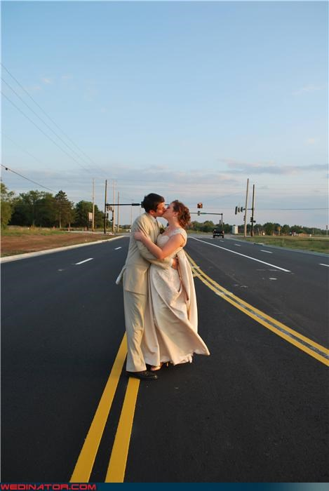 confusing,Crazy Brides,crazy groom,Funny Wedding Photo,middle of the road,roadside love,romance,romantic game of chicken,technical difficulties,traffic,were-in-love,wedding portrait,wtf