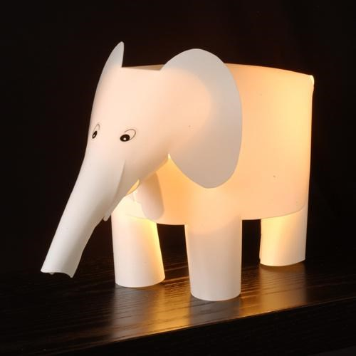 adults animals desk elephant kids lamp light Office paper