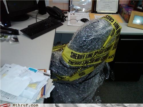 bubble wrap,caution tape,chair,cube,cubicle prank,desk,dickhead coworkers,ergonomics,prank,wrapping