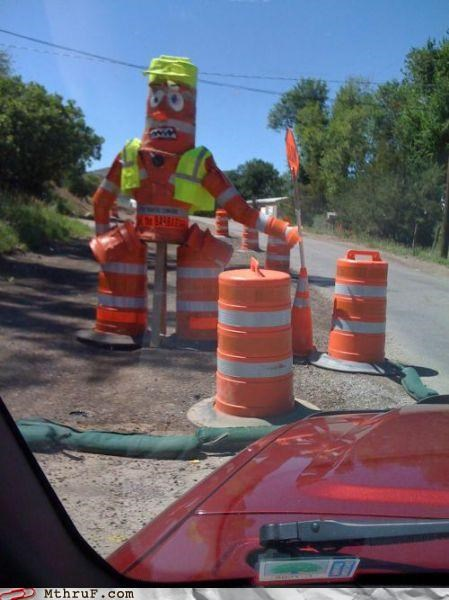 awesome,boredom,clever,cone,construction,creativity in the workplace,decoration,hardware,hazard,ingenuity,mess,orange cones,road construction,road work,safety,sculpture,Terrifying,warning,work smarter not harder