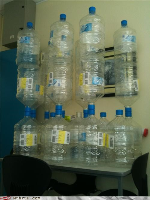 balanced,boredom,cubicle boredom,cubicle prank,decoration,dickheads,dumb,jenga,mess,prank,sass,sculpture,stacked,tower,unstable,water bottles,water cooler,wiseass