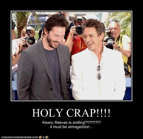 HOLY CRAP!!!! Keanu Reeves is smiling!?!?!?!?!? it must be armageddon...
