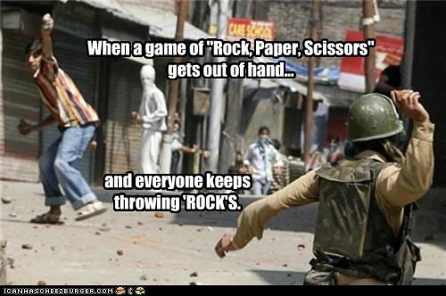 """When a game of """"Rock, Paper, Scissors"""" gets out of hand... and everyone keeps throwing 'ROCK'S."""