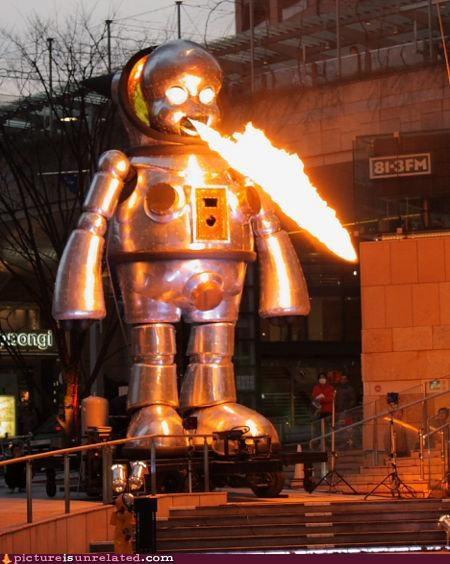 baby,creepy,fire,public art,robot,wtf