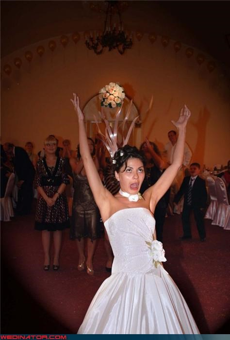 bouquet toss,bride throws her hands up,Crazy Brides,funny bouquet toss picture,funny wedding photos,sweaty bride,throw yo hands in the air,zombie bride