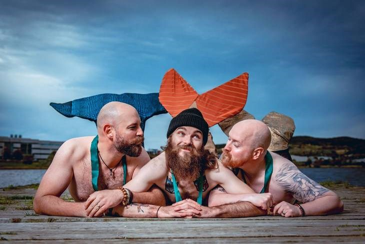 photoshoot of men with beards dressed as mermaids to challenge stuff