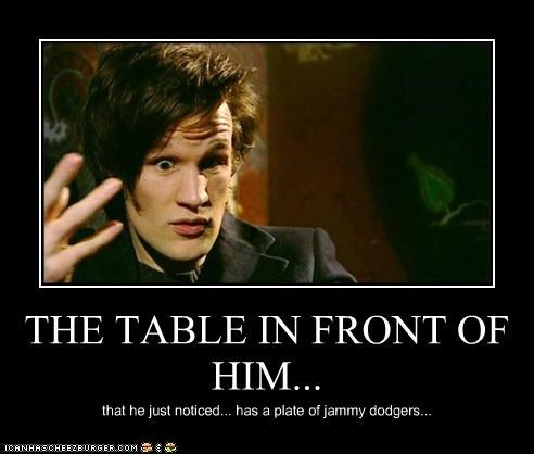 THE TABLE IN FRONT OF HIM...