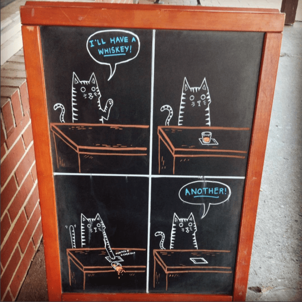 sidewalk signs featuring animals
