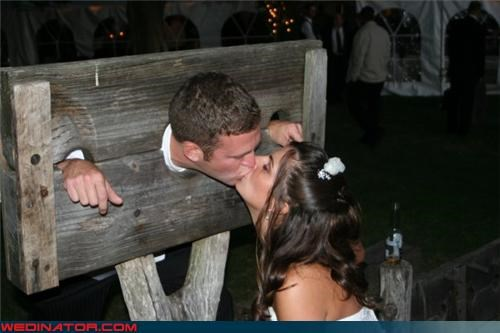bride,bride and groom kissing,colonial america,confusing,crazy groom,crazy wedding picture,Crime And Punishment,funny wedding photos,surprise,technical difficulties,the stocks,were-in-love,wtf,wtf is this