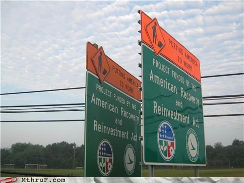 overcompensating road signs signs tax dollars