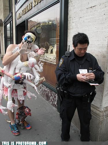 costume Impending Doom monster photobomb police officer so many things wtf