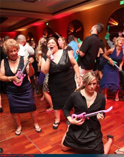 air guitar awesome wedding picture awesome wedding reception cheap thrills funny party favors funny wedding favors funny wedding photos peter frampton face Sheer Awesomeness surprise wedding favors wedding guests rocking wedding party Wedding Themes