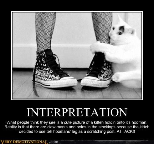 INTERPRETATION What people think they see is a cute picture of a kitteh holdin onto it's hooman. Reality is that there are claw marks and holes in the stockings because the kitteh decided to use teh hoomans' leg as a scratching post. ATTACK!!