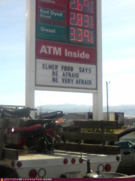 elmer fudd,gas station,ominous,sing,why is he warning us via a gas station sign,wtf