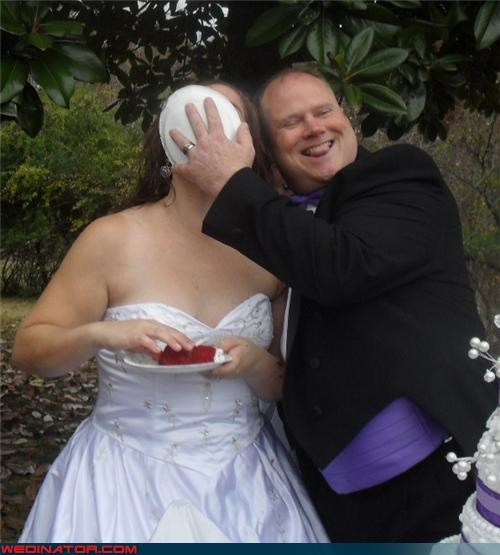 bride gets caked,cakeface,Crazy Brides,crazy groom,Dreamcake,eww,funny groom picture,funny wedding cake picture,funny wedding photos,groom-smashes-cake-in-brides-face,miscellaneous-oops,surprise,technical difficulties,were-in-love,wedding tradition