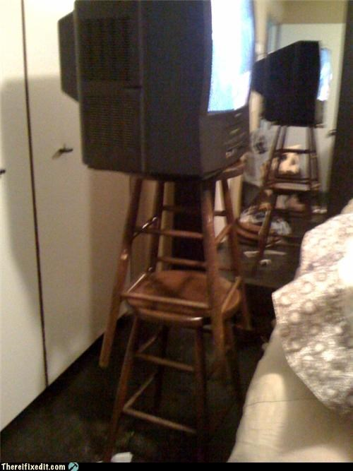cautionary fail,holding it up,stool,television